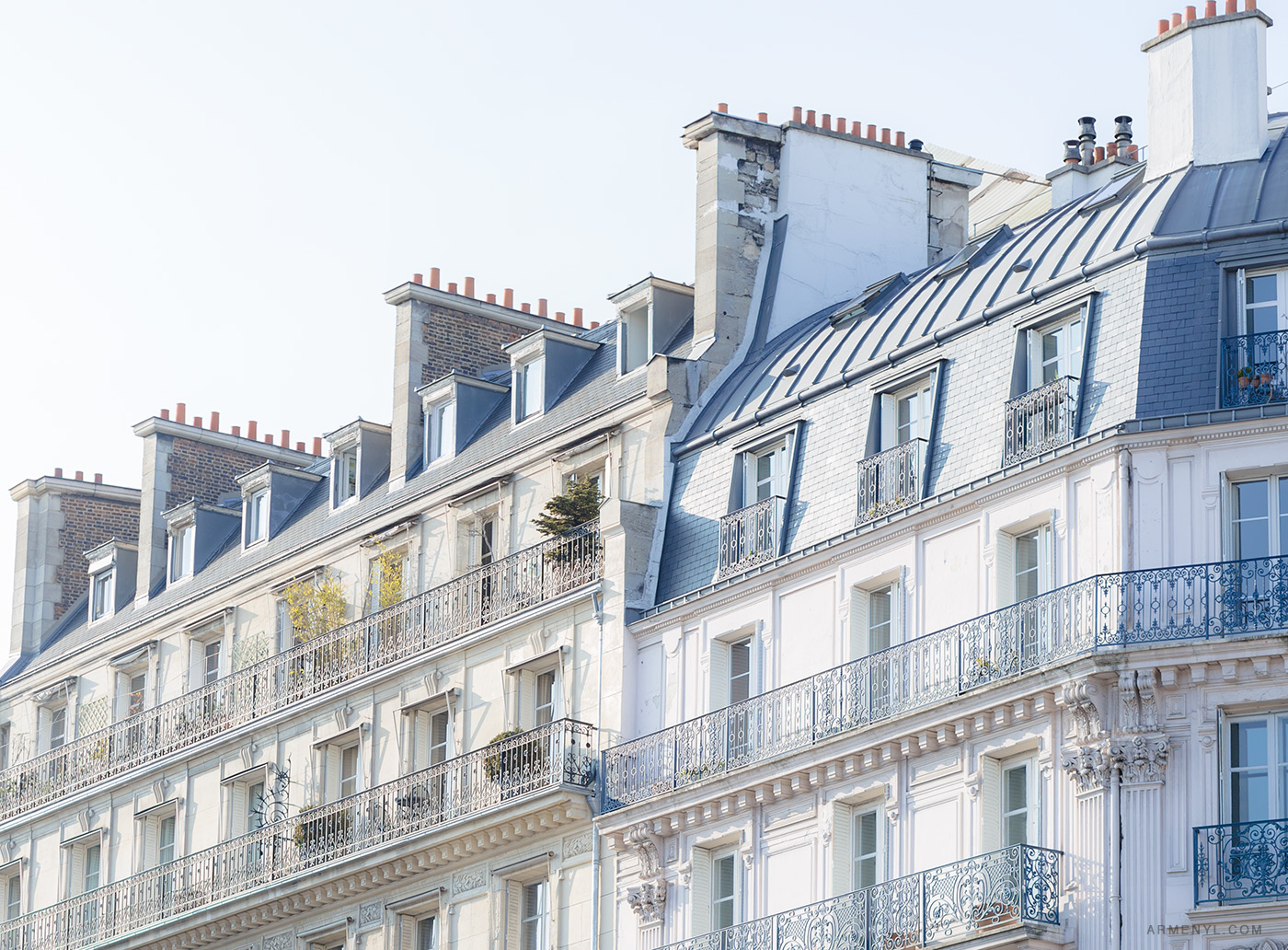 Parisian-buildings-and-rooftops-Sunny-day-in-Paris,-France-photographed-by-Armenyl.com